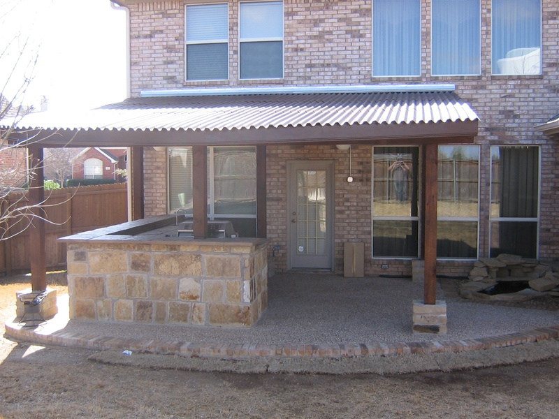 Patio Cover with Synthetic Roof and stone pillar accents