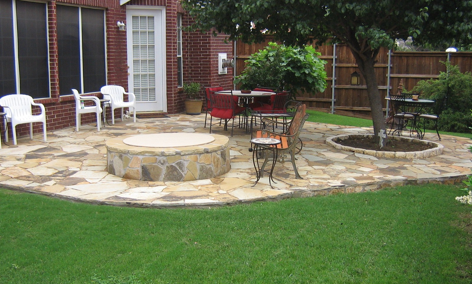 Flagstone patio home and lawn transformers for Flagstone patio designs